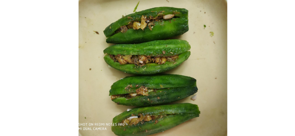 Seeds and spices in slit karela
